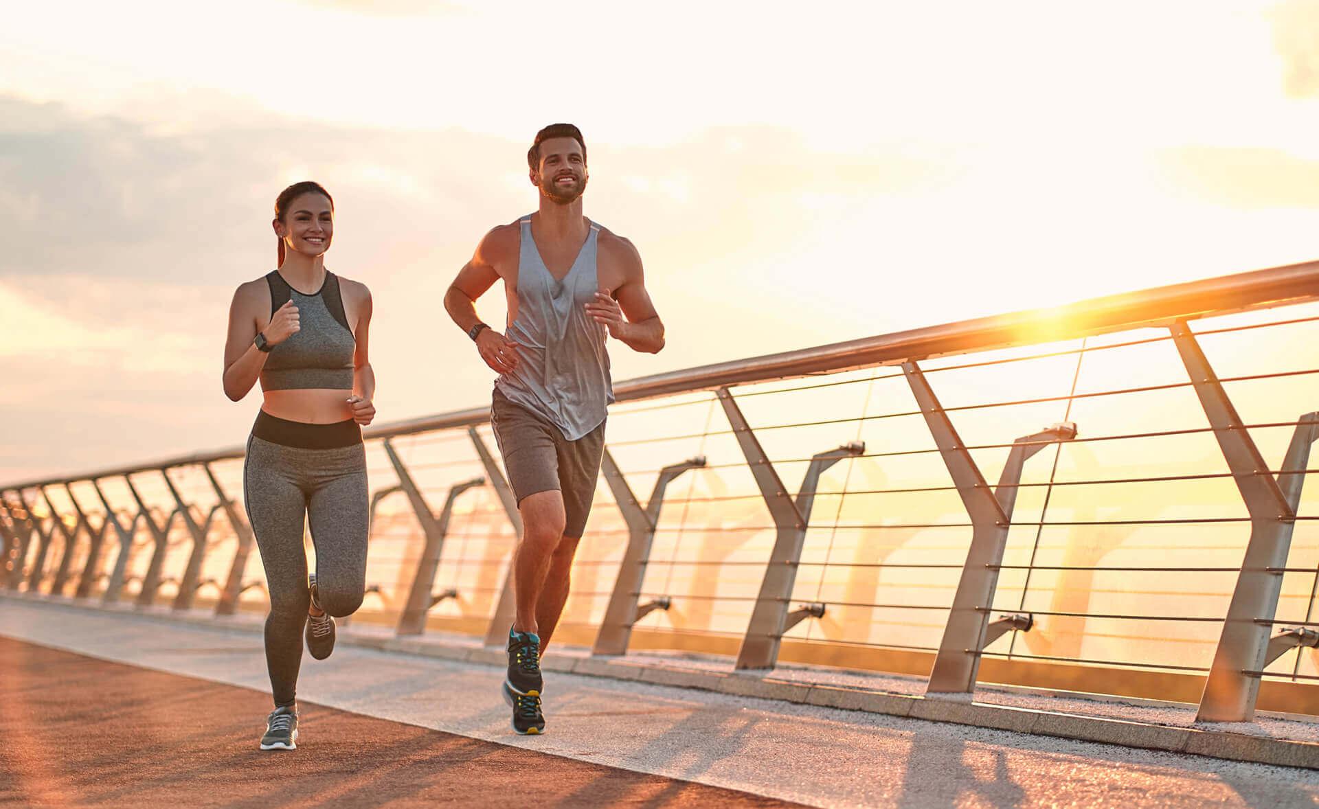 Couple jogging on bridge