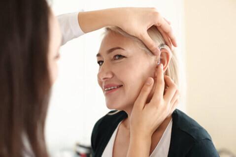 Woman having her ear examined