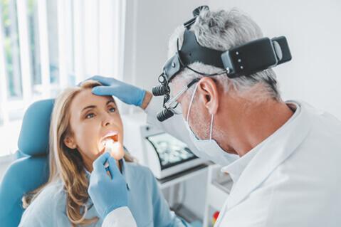 Woman having throat examined